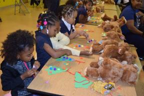 MacArthur K-2 grade students spent the evening creating a holiday craft and building a bear.